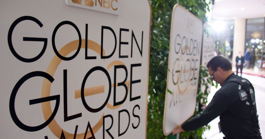 (FILES) This file photo taken on January 9, 2016 shows a worker adjusts signage in the arrivals area for the 73nd annual Golden Globe Awards, at the Beverly Hilton Hotel in Beverly Hills, California.Hollywood's elite hits the red carpet on January 8, 2017 for the 74th Golden Globes, launching a fiercely-contested awards season that looks set to reward escapist fantasy and gritty drama in equal measure.  / AFP PHOTO / ROBYN BECK