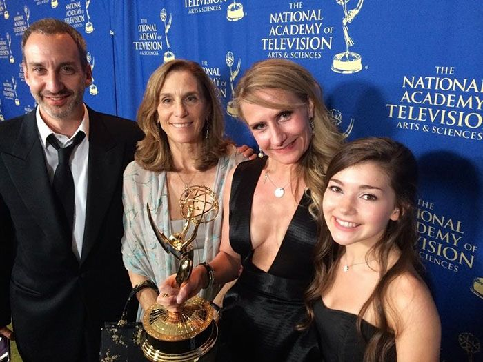"""Rebekka Sorenson (second from right) with her 2014 Emmy award is joined by James Krieg (L), producer Jane Startz and actress Katie Douglas from Hub's """"Spooksville"""""""