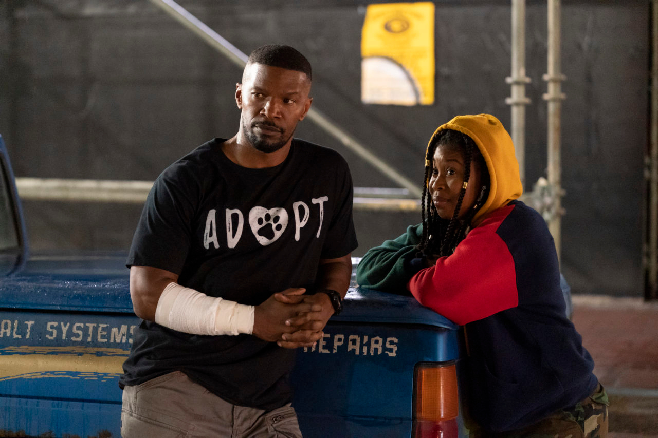 jamie foxx as art and dominique fishback as robin in project power