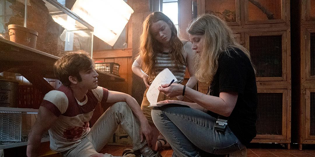 (L to R) Actors Ted Sutherland, Sadie Sink, and Leigh Janiak on the set of 'Fear Street Part 3: 1666'