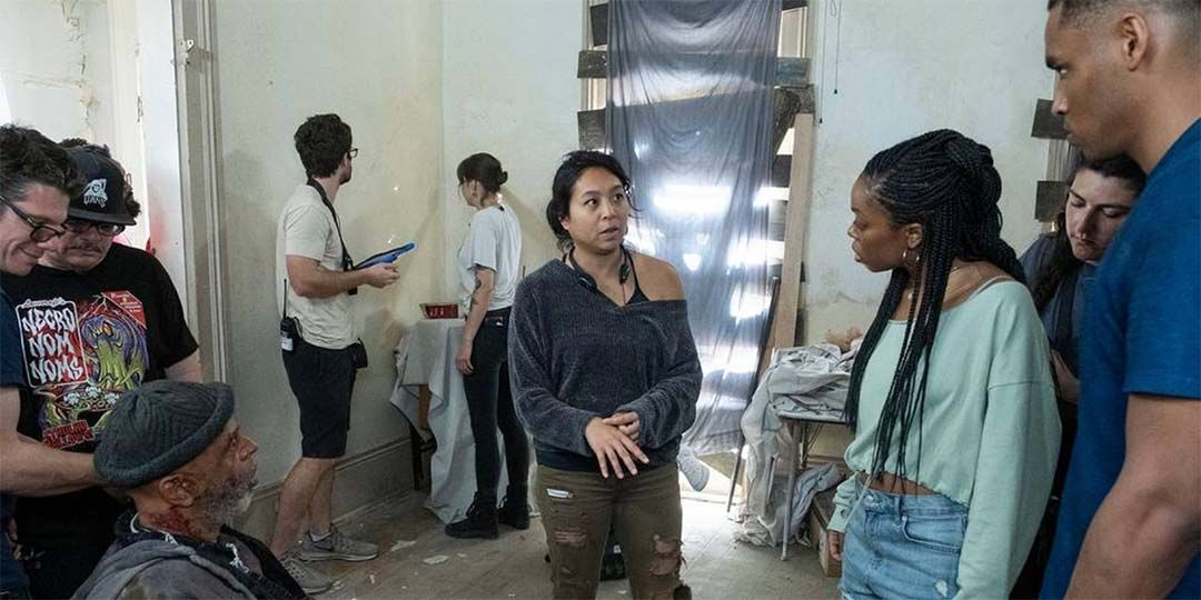 Maritte Lee Go (center) talks to Asjha Cooper (right) on the set of 'Black As Night'